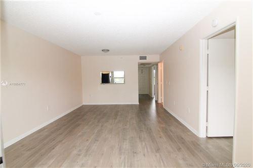 Photo of 550 SW 137th Ave #306L, Pembroke Pines, FL 33027 (MLS # A10864771)