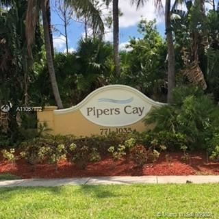 Photo of 1000 Pipers Cay Dr #119, West Palm Beach, FL 33415 (MLS # A11057772)