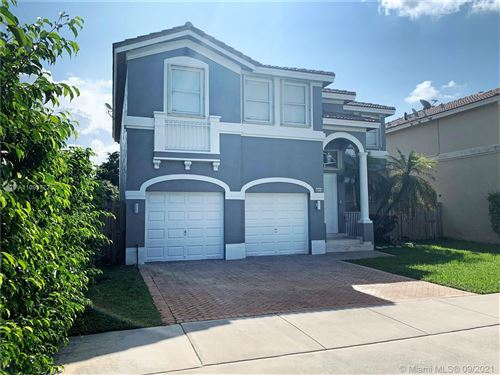 Photo of 4873 NW 113th Pl, Doral, FL 33178 (MLS # A11098772)