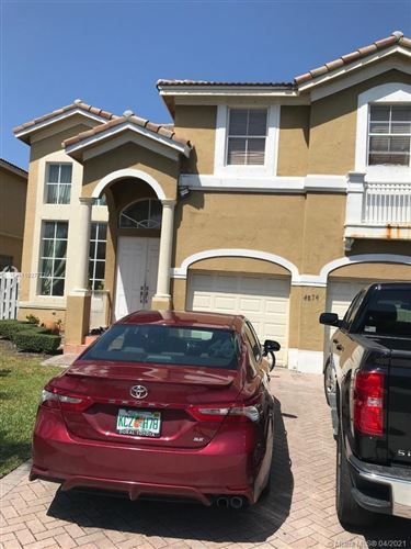 Photo of 4874 NW 113th Pl, Doral, FL 33178 (MLS # A11027773)