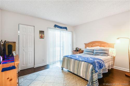 Photo of 1125 Lake Shore Dr #105, Lake Park, FL 33403 (MLS # A10832774)