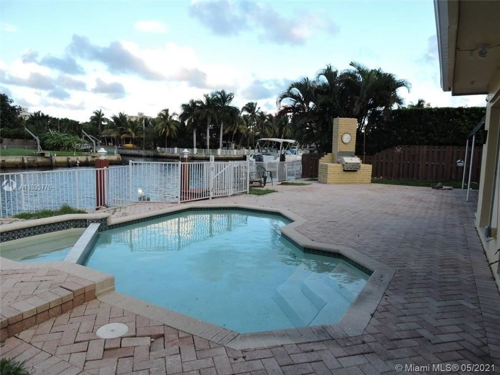 Photo of 2055 Ixora Rd, North Miami, FL 33181 (MLS # A11035776)