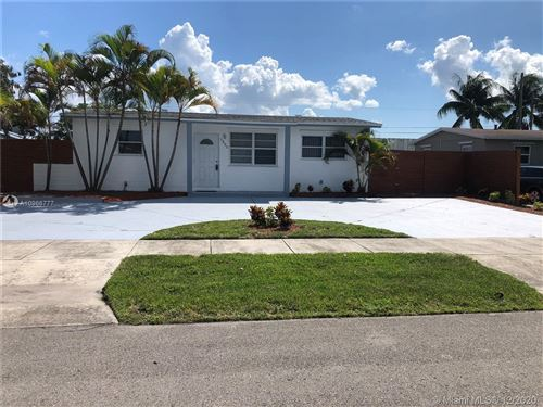Photo of 1220 NW 41st St, Oakland Park, FL 33309 (MLS # A10966777)