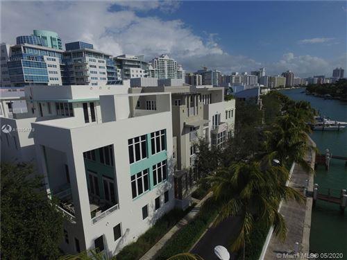 Foto de inmueble con direccion 213 Ari Way #213 Miami Beach FL 33141 con MLS A10854779