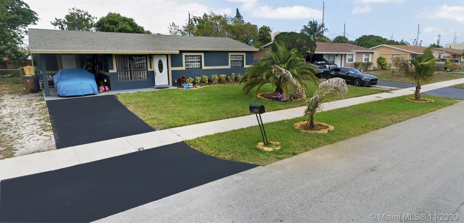 Photo of 821 NE 51st Ct, Deerfield Beach, FL 33064 (MLS # A10957779)