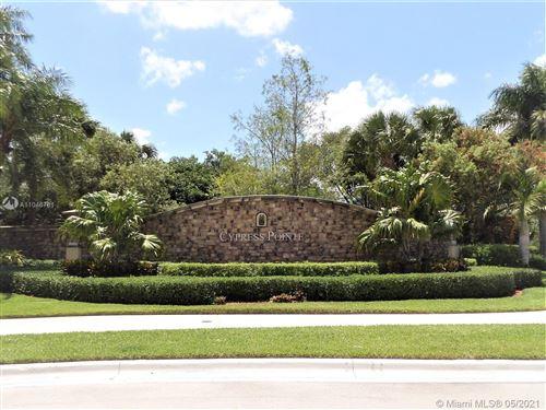 Photo of 7994 NW 128th Ln #6-D, Parkland, FL 33076 (MLS # A11046781)