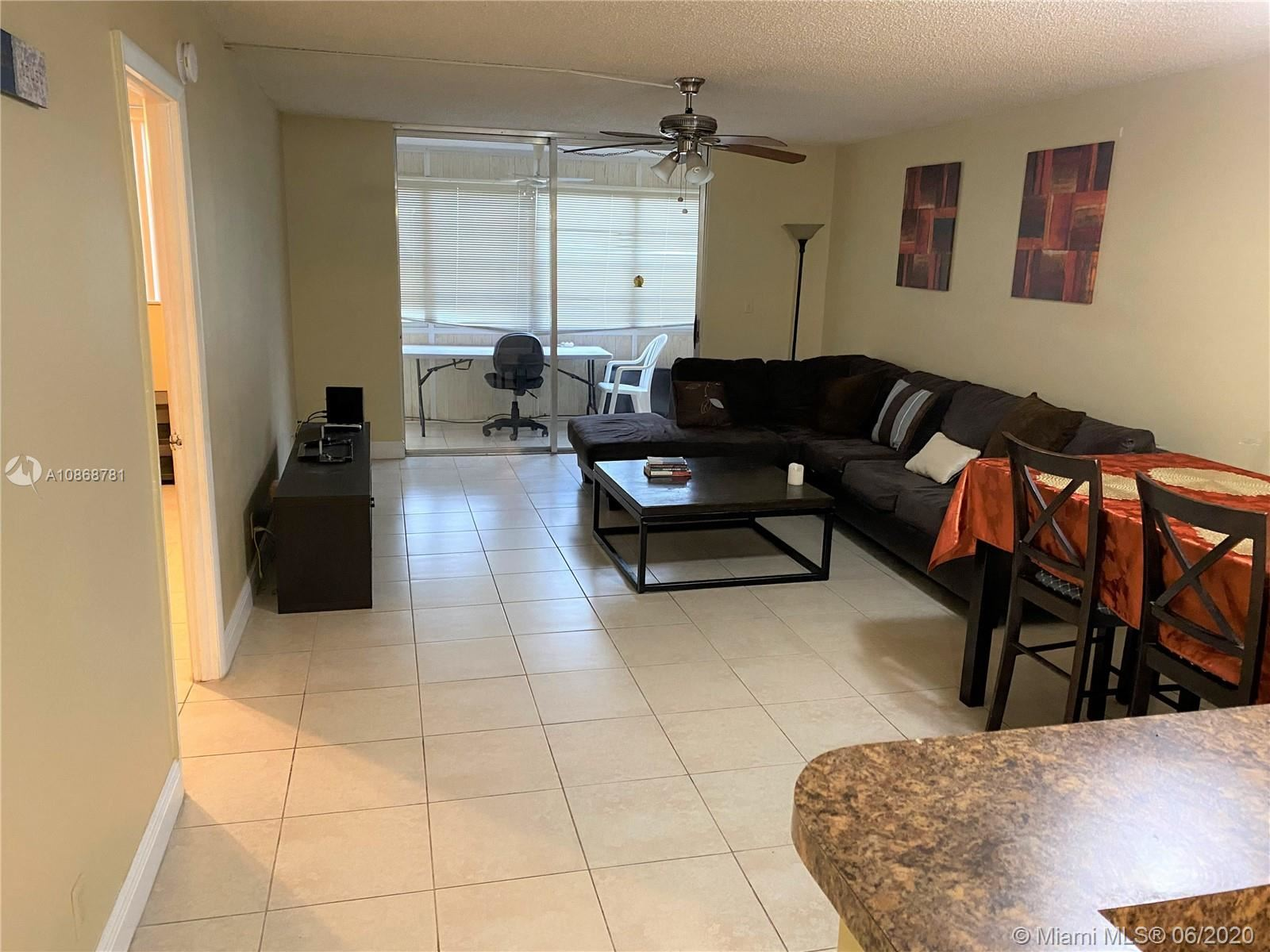 Photo of 410 NW 68th Ave #207, Plantation, FL 33317 (MLS # A10868781)