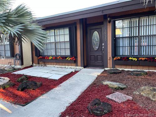 Photo of 10120 Woodbury Ct #10120, Pembroke Pines, FL 33026 (MLS # A11054782)