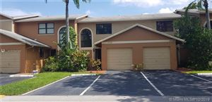 Photo of 10584 NW 6th St, Pembroke Pines, FL 33026 (MLS # A10704783)