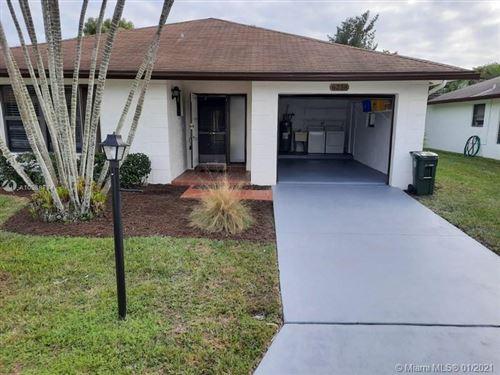Photo of 6258 Blue Baneberry Ln, Green Acres, FL 33463 (MLS # A10988784)
