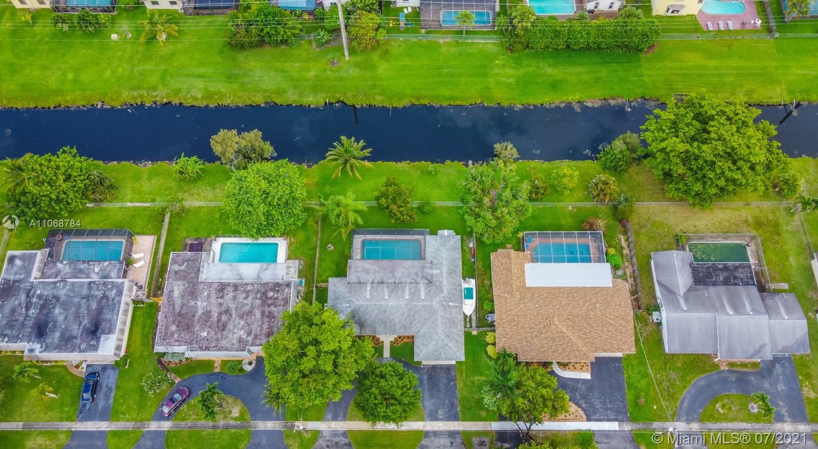Photo of 1321 NW 75th Ter, Plantation, FL 33313 (MLS # A11068784)