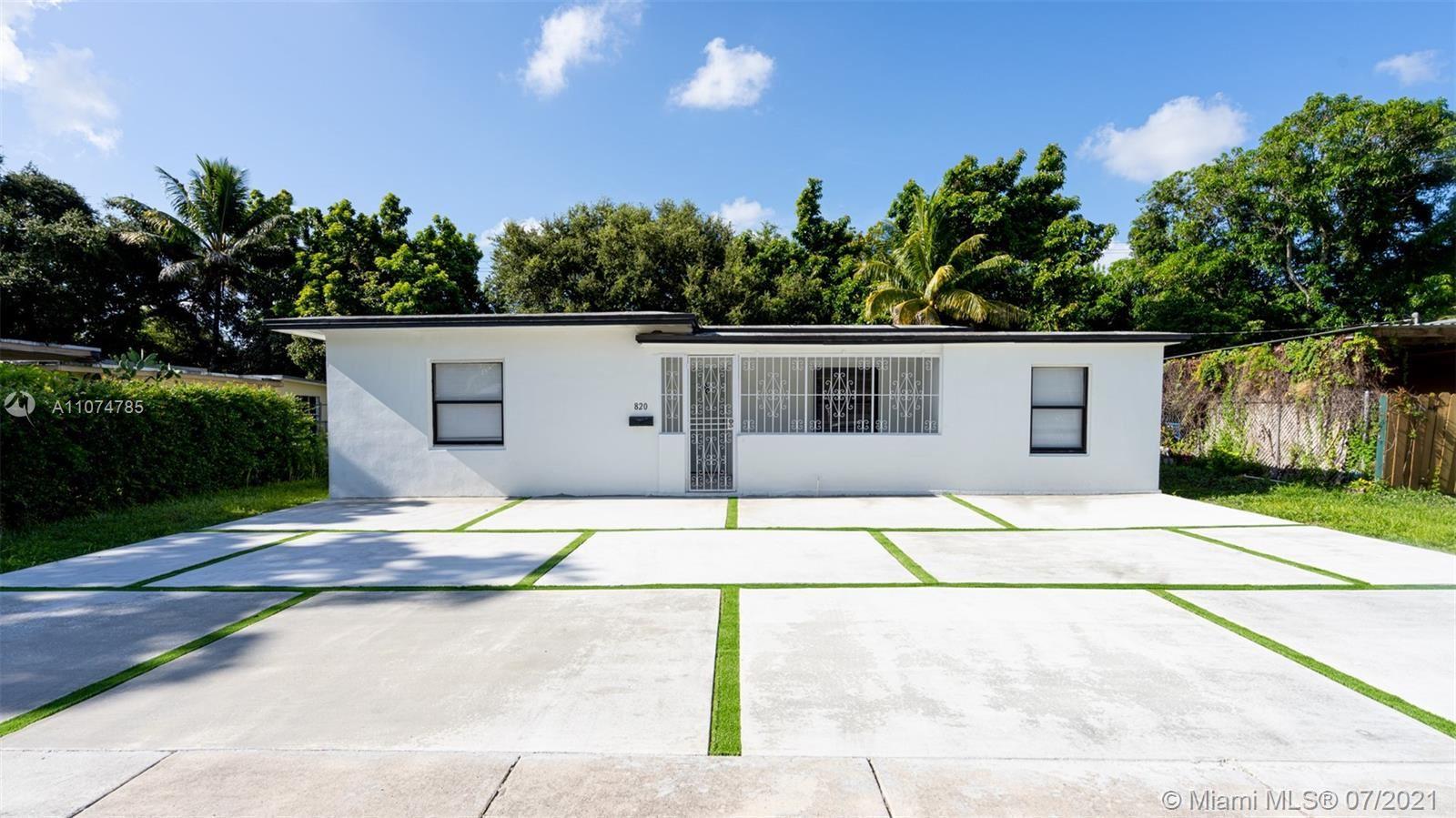 Photo of 820 NE 143rd St, North Miami, FL 33161 (MLS # A11074785)