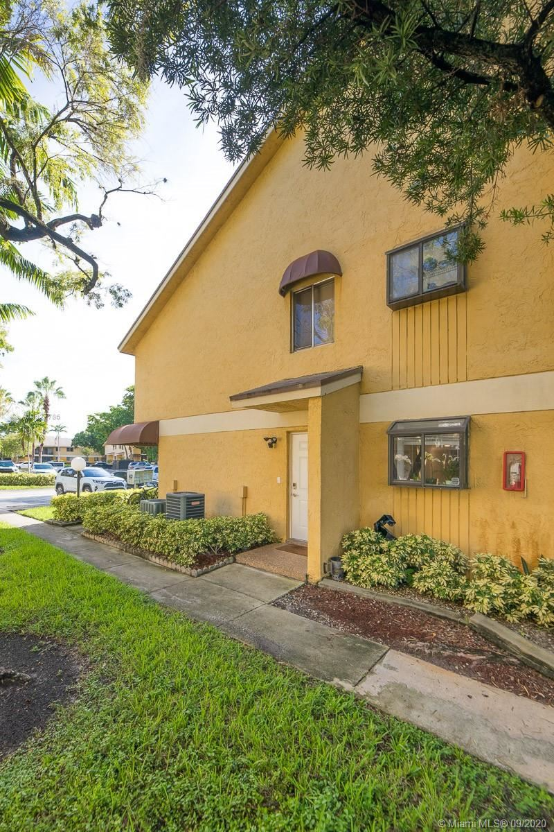 Photo of 3041 N Oakland Forest Dr #102, Oakland Park, FL 33309 (MLS # A10927786)