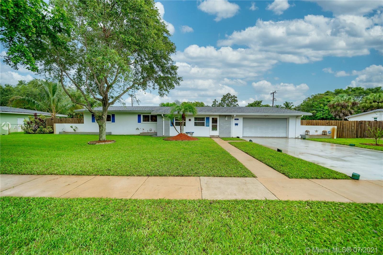 Photo of 741 Gardenia Ln, Plantation, FL 33317 (MLS # A11071786)