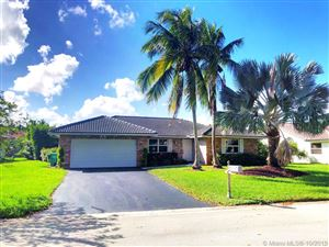 Photo of 1242 NW 111th Ave, Coral Springs, FL 33071 (MLS # A10761787)