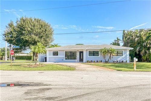 Photo of 1427 Beta Cir, Lake Clarke Shores, FL 33406 (MLS # A11093790)