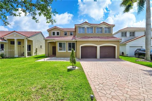 Photo of 1302 Camellia Lane, Weston, FL 33326 (MLS # A10806791)