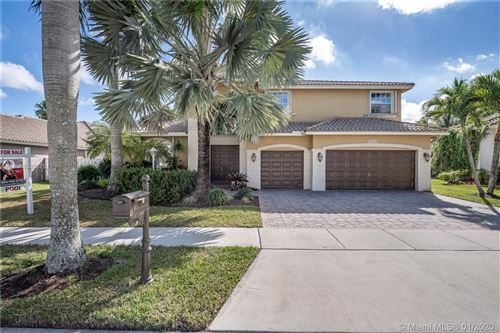 Photo of 13794 NW 19th St, Pembroke Pines, FL 33028 (MLS # A10808791)