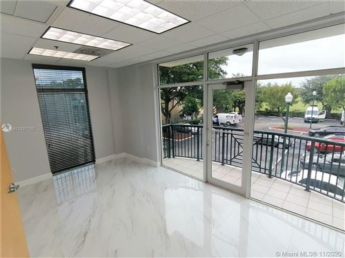 Photo of 5803 NW 151st St #200-A, Miami Lakes, FL 33014 (MLS # A10931792)
