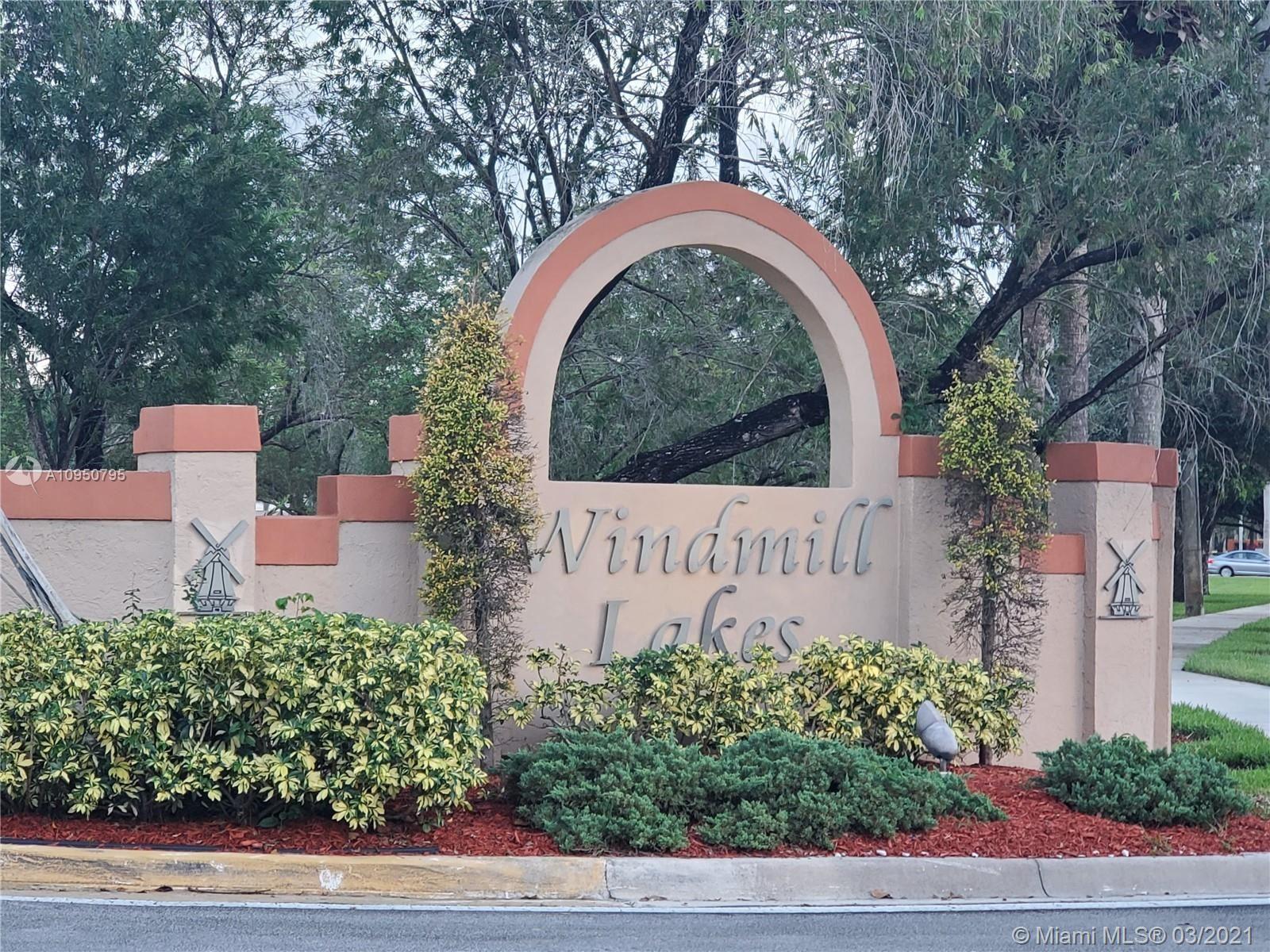 Photo of 8710 SW 3rd St #205, Pembroke Pines, FL 33025 (MLS # A10950795)