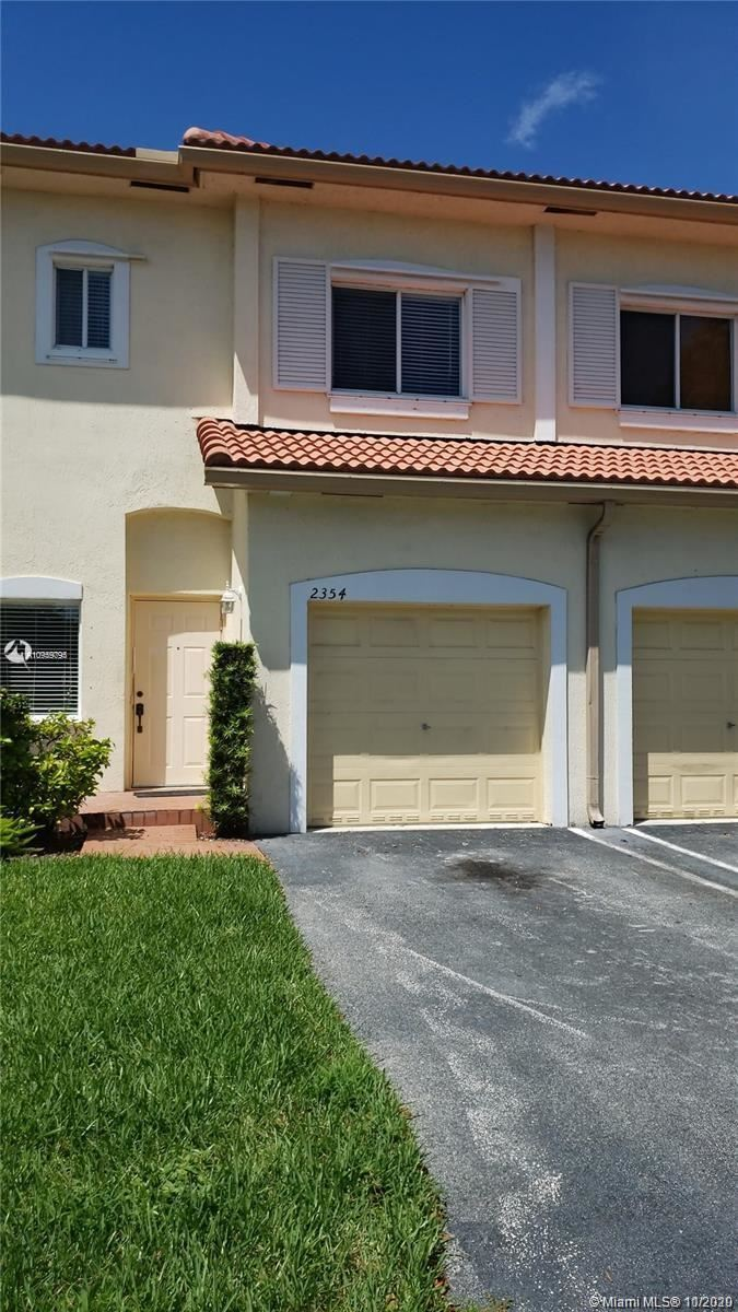 Photo of 2354 Coral Springs Drive #8, Coral Springs, FL 33065 (MLS # A10959795)