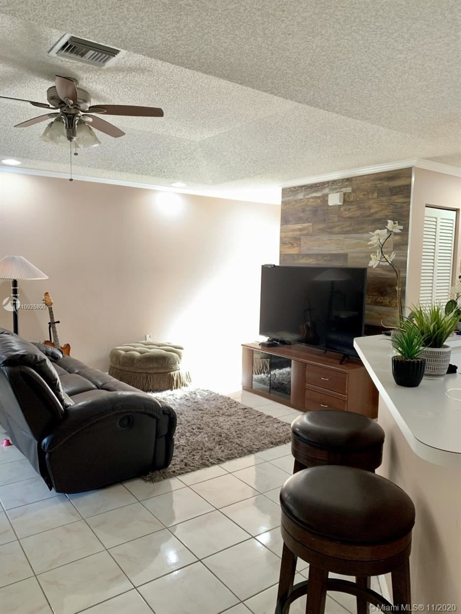 Photo of 4032 Eastridge Dr, Deerfield Beach, FL 33064 (MLS # A10925800)