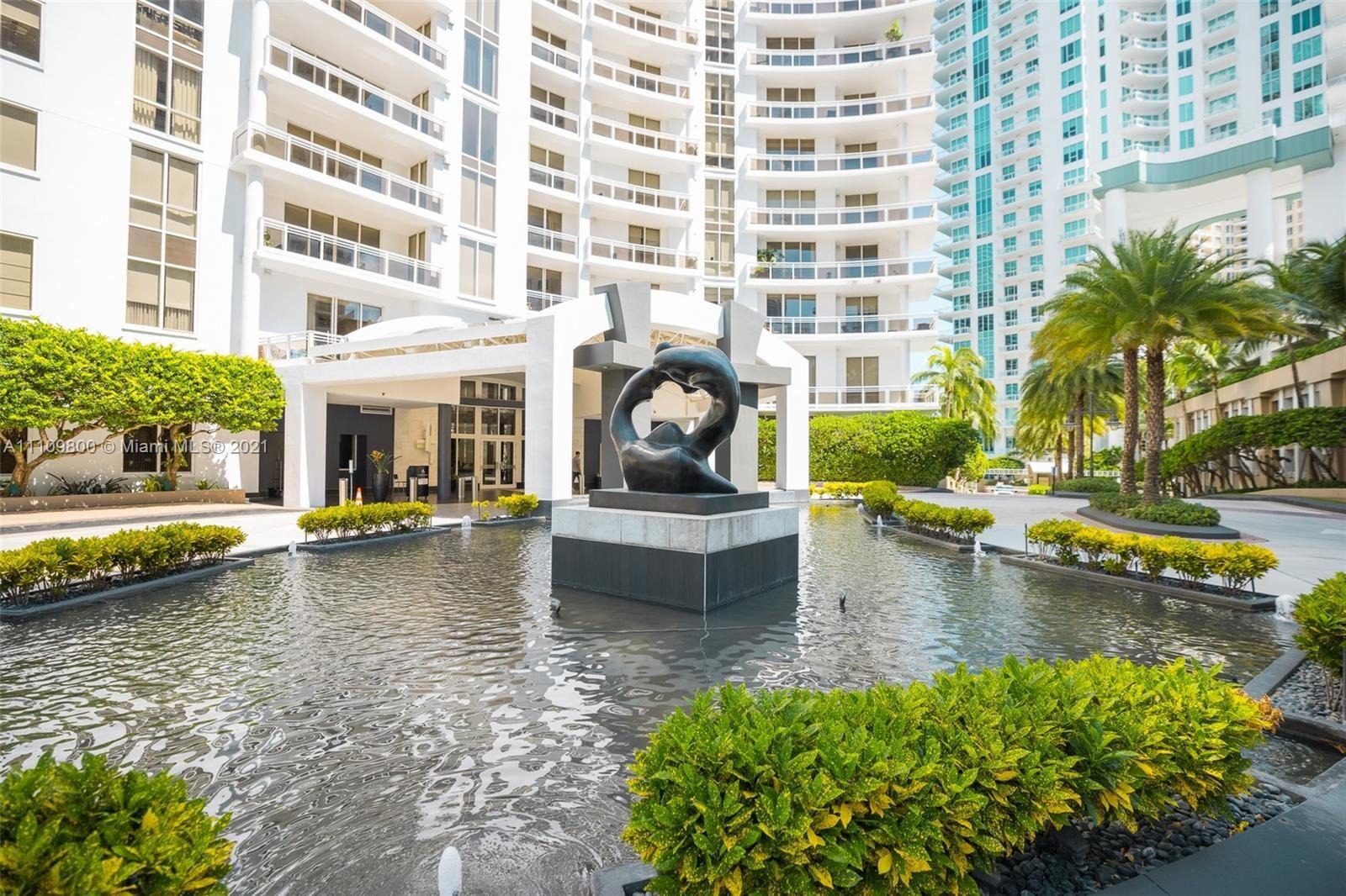 Photo of 901 Brickell Key Blvd #3205, Miami, FL 33131 (MLS # A11109800)