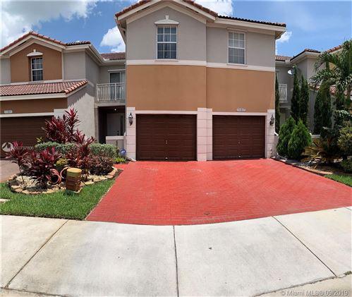 Photo of 11487 NW 80th Ln, Doral, FL 33178 (MLS # A10737806)