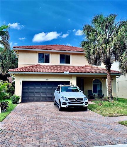 Photo of 320 Venice Blvd, Royal Palm Beach, FL 33411 (MLS # A11051806)
