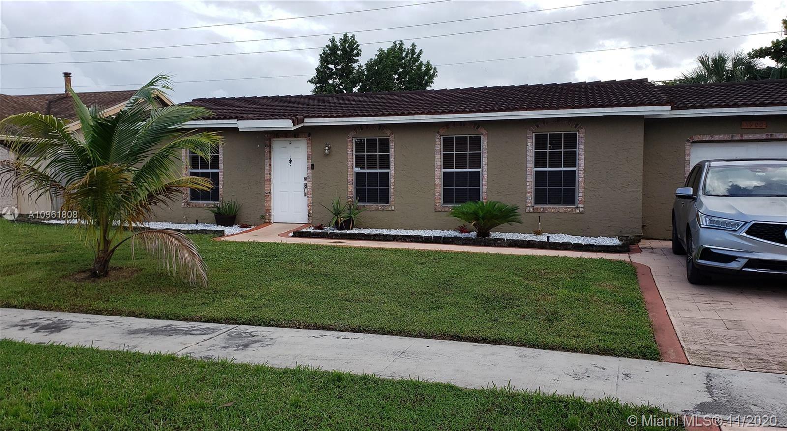 Photo of 7900 NW 44th Ct, Lauderhill, FL 33351 (MLS # A10961808)