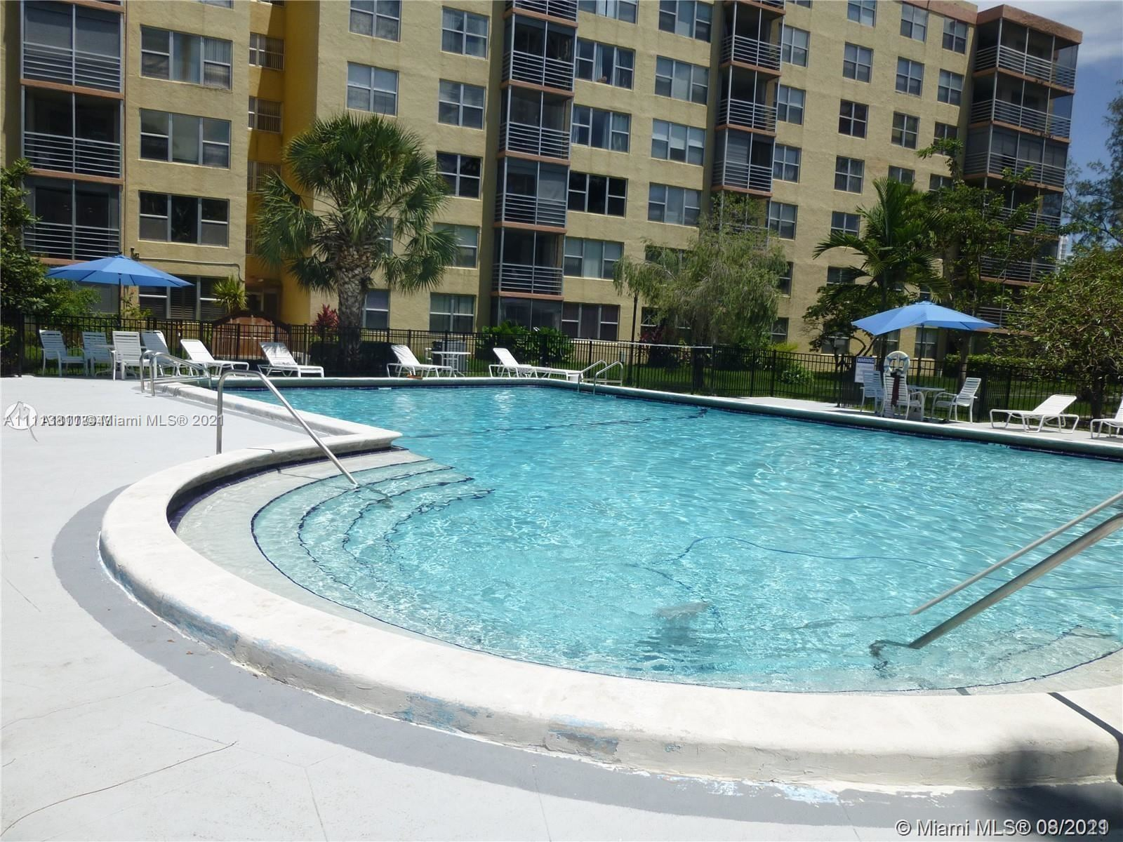 Photo of 17890 W dixie hwy #302, North Miami, FL 33160 (MLS # A11113811)