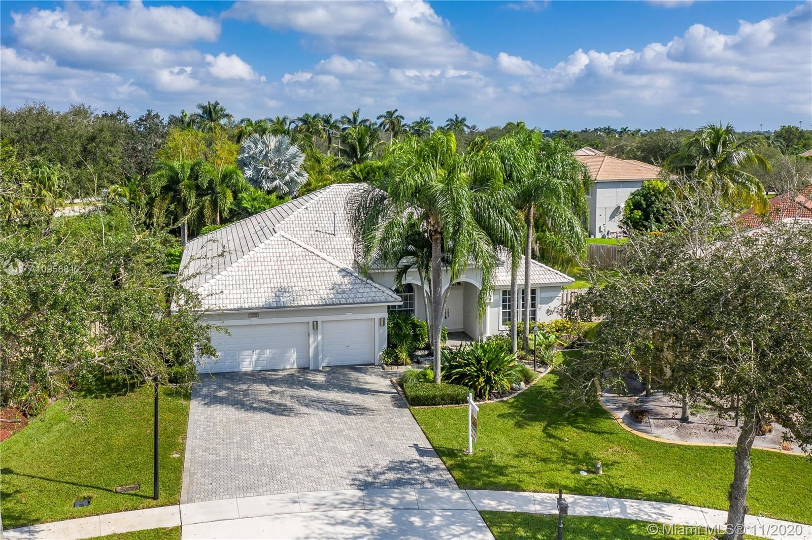 Photo of 2299 NW 128th Ave, Pembroke Pines, FL 33028 (MLS # A10956812)