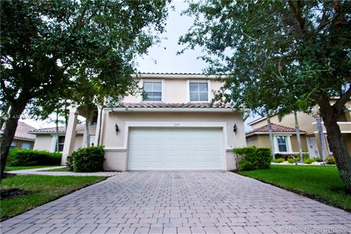 Photo of 1573 SW 189th Ave, Pembroke Pines, FL 33029 (MLS # A10794813)