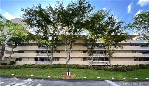 Photo of 7001 Environ Blvd #207, Lauderhill, FL 33319 (MLS # A10838814)