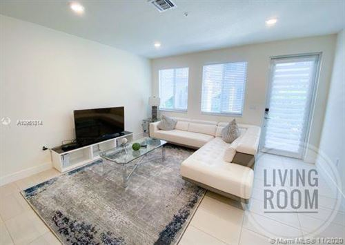 Photo of 10226 NW 64th Ter #107, Doral, FL 33178 (MLS # A10961814)