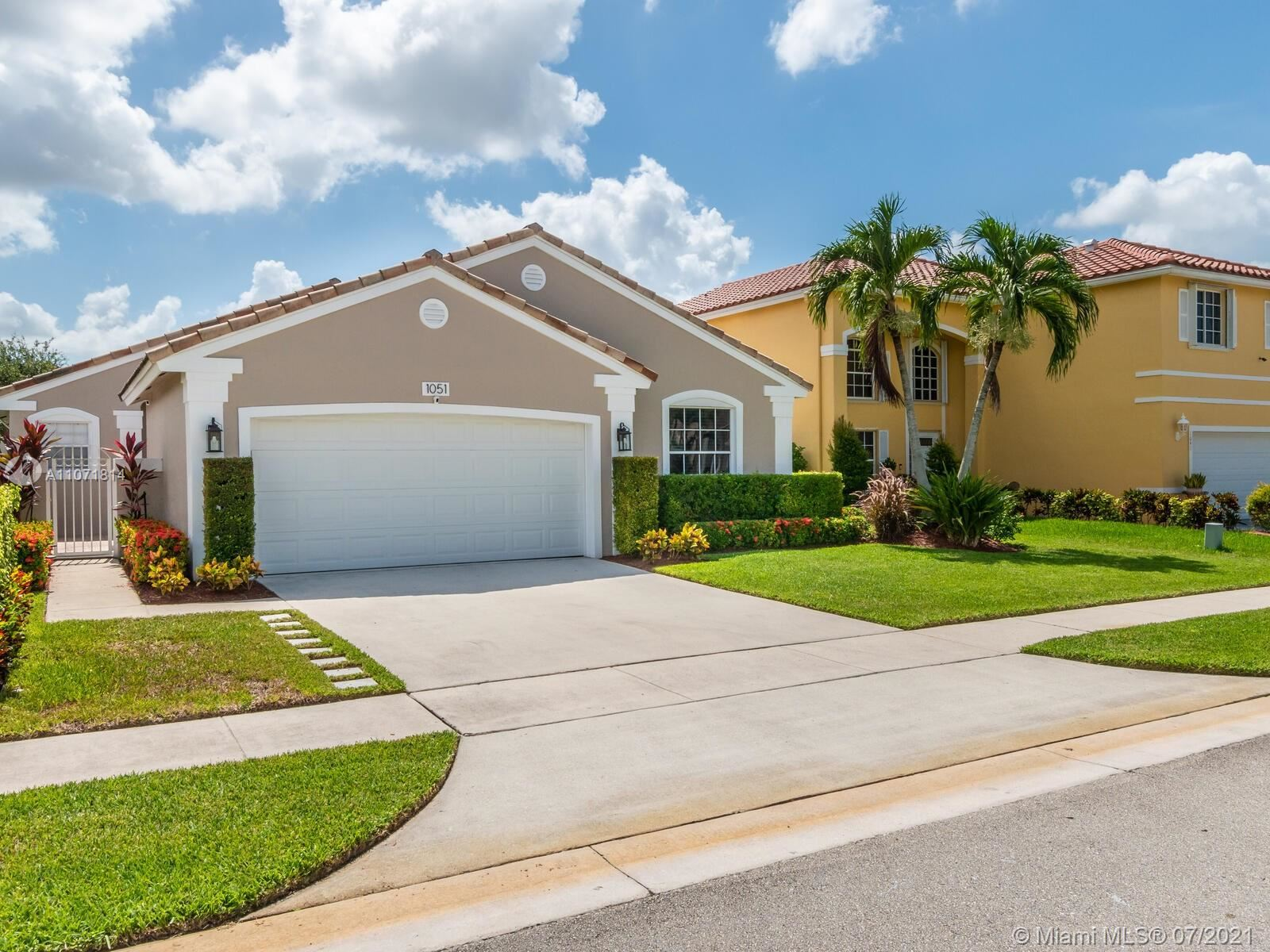 Photo of 1051 NW 189th Ave, Pembroke Pines, FL 33029 (MLS # A11071814)