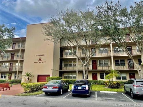 Photo of 13475 SW 9th St #312A, Pembroke Pines, FL 33027 (MLS # A10981818)