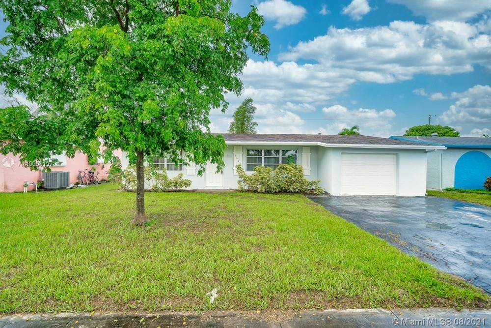 Photo of 9550 NW 26th Place, Sunrise, FL 33322 (MLS # A11069819)