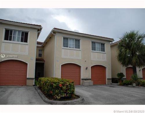 Photo of 2430 Centergate Dr #105, Miramar, FL 33025 (MLS # A10927822)