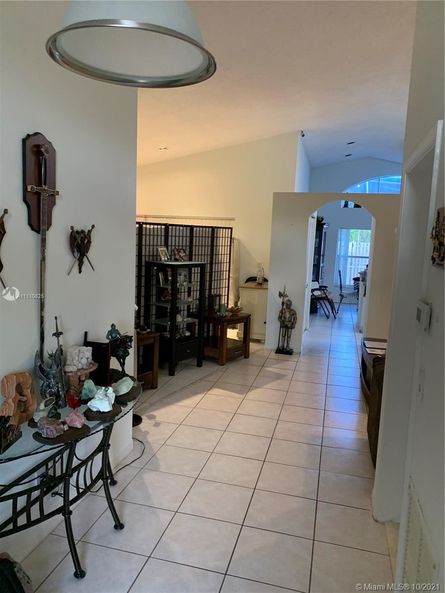 Photo of 5362 NW 55th Ter, Coconut Creek, FL 33073 (MLS # A11110825)