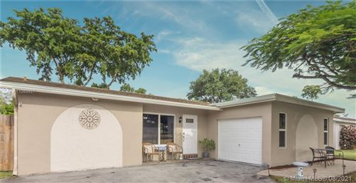 Photo of 1020 NW 93rd Ave, Pembroke Pines, FL 33024 (MLS # A11089827)