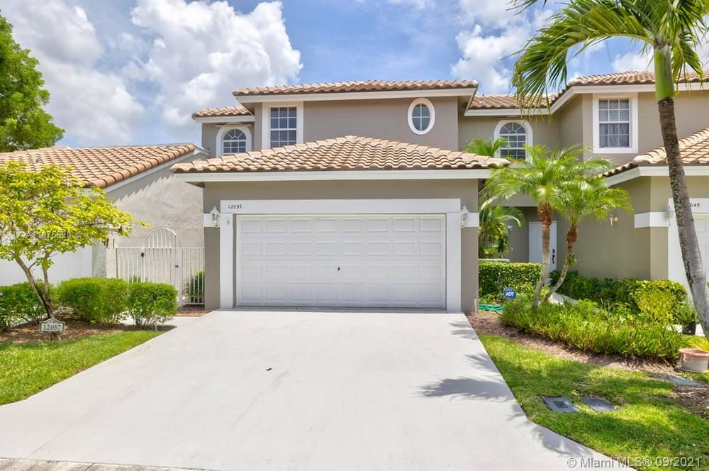 Photo of 12057 NW 56th Street #12057, Coral Springs, FL 33076 (MLS # A11075829)