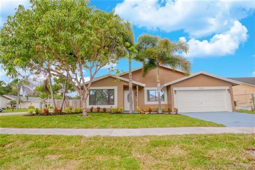 Photo of 5207 NW 99th Ave, Sunrise, FL 33351 (MLS # A10863830)