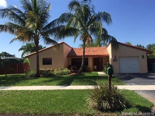 Photo of 11291 SW 55th St, Cooper City, FL 33330 (MLS # A10546831)