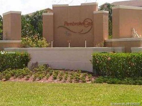 Photo of 1085 SW 143rd Ave #1207, Pembroke Pines, FL 33027 (MLS # A10933835)