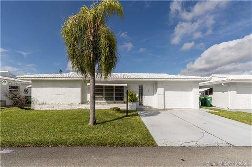 Photo of 5905 NW 87th Ave, Tamarac, FL 33321 (MLS # A10946838)