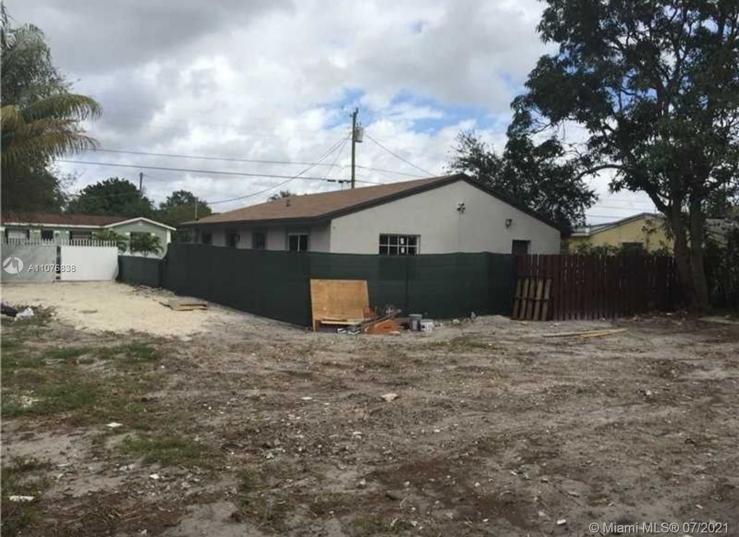 Photo of 2448 NW 102nd St, Miami, FL 33147 (MLS # A11076838)
