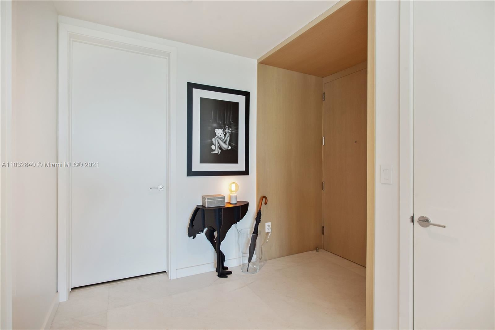 Photo of 10203 Collins Ave #211, Bal Harbour, FL 33154 (MLS # A11032840)