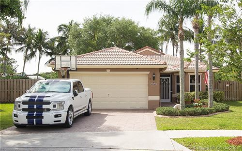 Photo of 4096 Oxbow Dr, Coconut Creek, FL 33073 (MLS # A11023842)