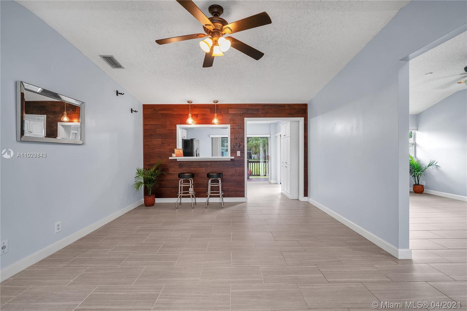 Photo of 370 E Lakewood Cir E #D, Margate, FL 33063 (MLS # A11029843)